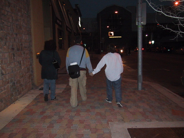 Me and Adam holding hands at SXSW 2002. Also featuring Maura!