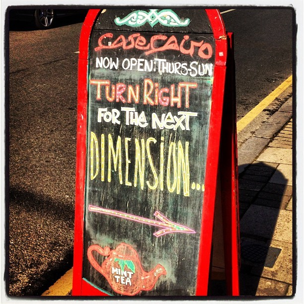 Cafe Cairo Sign: Turn Right For The Next Dimension #streetsign #typography #cafeCairo #Stockwell #London #timetravel (Taken with Instagram at Cafe Cairo)