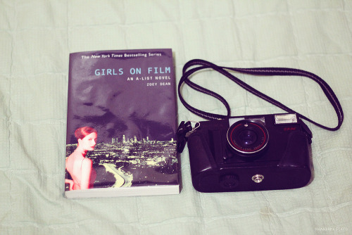 52/365 What to bring on a trip. perfect book to read film camera (mom bought this in Africa during her trip)