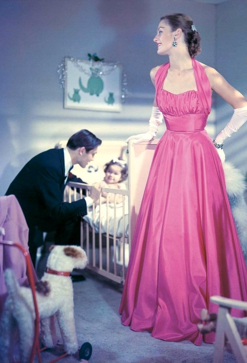 theniftyfifties:  A glamorous couple bids goodnight to their daughter, 1950s.