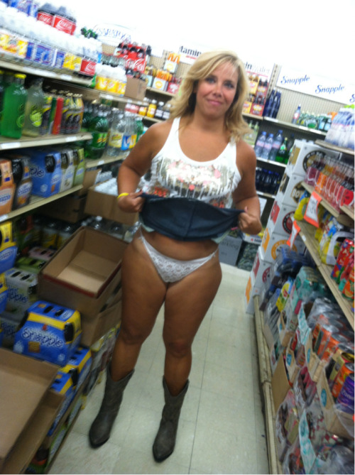 stunningmilf:  Showing it off in the Beer Store!