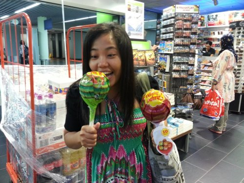 my older sister, Roswitha, and a pair of over-sized lollipops at frankfurt terminal last week. She turns 30 this december but doesn't look like it.