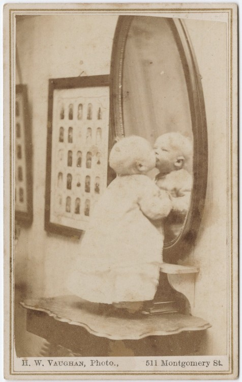 ca. 1855-95, [carte de visite portrait of a baby standing kissing his reflection], Hector William Vaughn via the Yale Collection of Western Americana, Beinecke Rare Book and Manuscript Library, Carl Mautz Collection