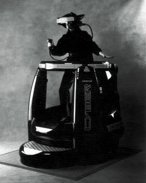 "the virtuality 1000CS/SD.my first experience in virtual reality was this pod thing at a place called 'cyberia' decades ago. old neon dead tech arcades. damn me, i am old.  ""…the block-wide Fuller domes that had been the holo temples of Parker's childhood became multilevel supermarkets, or housed dusty amusement arcades where you still might find the old consoles, under faded neon pulsing APPARENT SENSORY PERCEPTION through a blue haze of cigarette smoke."" - Gibson, Fragments of a Hologram Rose"
