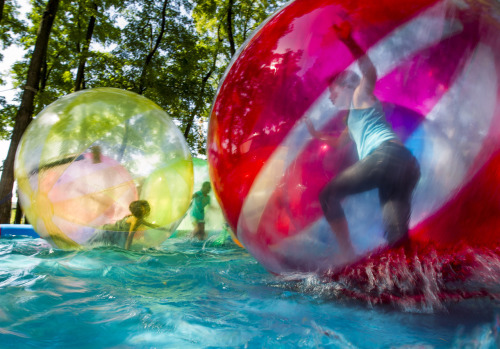 Photo of the Day: Children play in aqua zorbing balls in a temporary inflatable pool in the garden of the Chancellery during open house day in Berlin