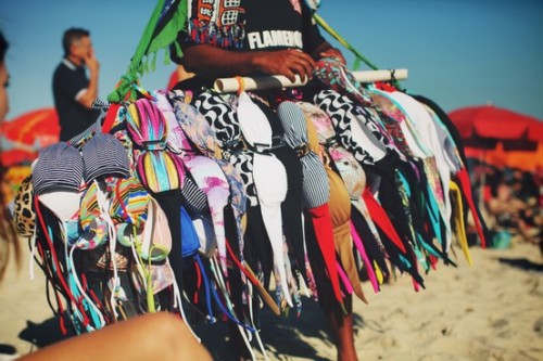In Brazil, they sell bikinis on the beach! In case beachgoers decide they don't like the one they're rocking, I guess? Too funny!photo by jane aldridge