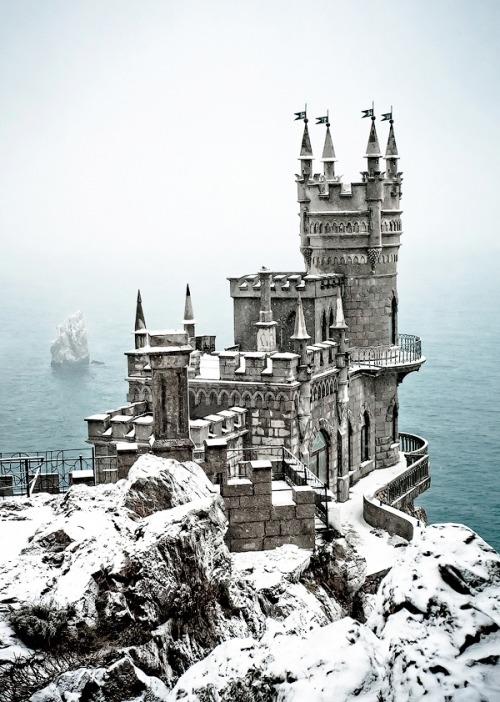 "evocativesynthesis:  ""Palace Swallow's Nest"" by Tim Zizifus; Info from National Geographic: The neo-Gothic Swallow's Nest castle perches 130 feet (40 meters) above the Black Sea near Yalta in southern Ukraine. Built by a German noble in 1912, the flamboyant seaside residence now houses an Italian restaurant."