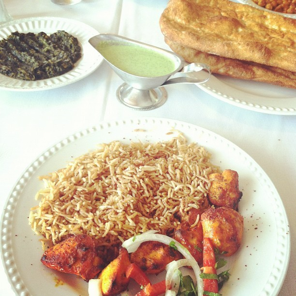 Chicken Kabob with rice, chutnee sauce, spinach, and naan
