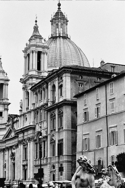 A quiet view of the Piazza Navona with a Bernini fountain and church.   Shot in black and white film in Rome in 2008.