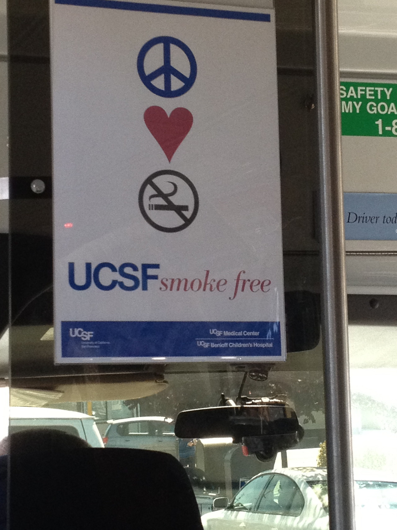 "I was on the red shuttle bus heading to the UCSF Mission Bay campus to listen to guest speakers talk about an array of research projects they have done for their masters. The little reminder of no smoking was very pleasing to see since I am fond of the slogans ""Peace, Love, (insert any antics that appeals to the eye)""."