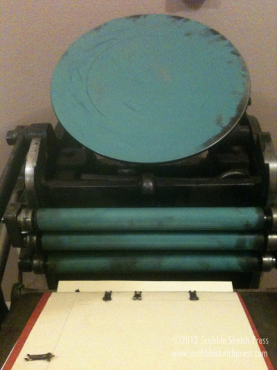 scribblesketch:  The press is all inked up! I love printing in turquoise.