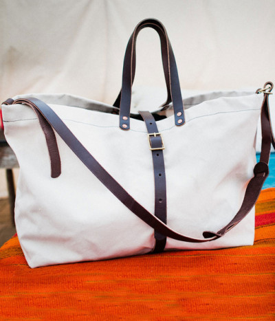 "Bexar Goods Co. Weekender Bag This weekender bag is perfect for quick trips out of town or a day spent at the beach. It features a 10/12-ounce Whiskey Brown English bridle vegetable tanned leather straps that will develop a rich ""patina"" with daily abuse, hand-hammered industrial grade copper rivets, industrial grade thick nylon thread, 20 inch hard straps and more."