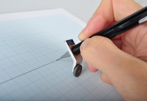 Constrained Ball,  Giha Woo. A drawing aid attached to a pen, this device helps to draw straight lines without using a ruler.