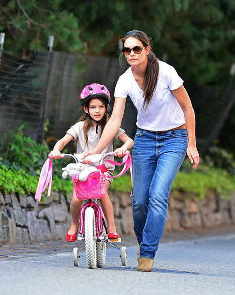 Snapshot Of The Day: Katie Holmes teaches Suri Cruise how to ride a bike! Click for more!