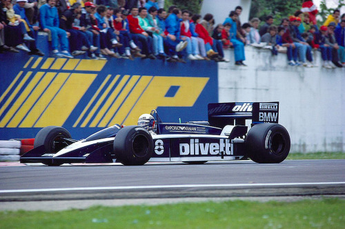 timewastingmachine:  Grandstand Brabham BT55 car #8 Elio de Angelis | 1986 San Marino GP  Get low! This was another of Gordon Murray's sleak designs for Brabham a la the sensations BT52 and of course the innovative BT46B fan car. Despite it's good looks it was too ambitious and ultimately failed due to forcing the tall BMW engine to be placed at an angle causing all sorts of drive train, crank shaft and gearbox issues. This car look familiar? Well it should, because this would inspire Murray, after moving to McLaren a year later, to design arguably the most dominating Formula One car of all time, the McLaren MP4/4. However, the beautiful BT55 also has a tragic note to it, when beloved Italian Elio de Angelis lost his life after flipping the car during an organised test session due in no small part to a lack of proper marshalling (fellow driver Alan Jones being the first on the scene - there were none stationed around the track) and no on-site helicopter - one had to be phoned in before he could be air some thirty minutes later. Despite only suffering a broken collar bone and burns to his back, Elio died from smoke inhalation - something that would have been prevented with appropriate marshalling.
