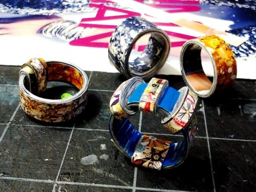 DIY Inspiration: Beautiful Paper Rings from Craft in the Country here. The rings are waterproof since they are sealed with several layers of polyurethane which also helps harden them. There are more examples of her rings at the link. First seen at  recyclart here.