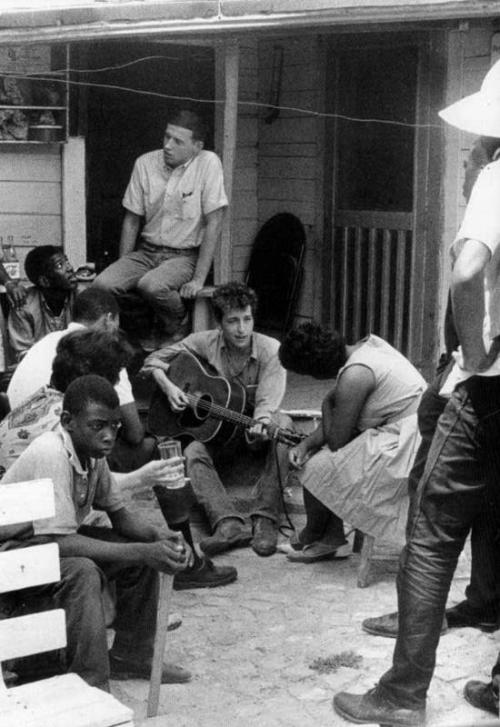 Bob Dylan in the backyard of the SNCC Office, Greenwood, Mississippi, July 8th, 1963, by Danny Lyon.