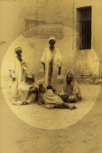 Five prisoners (possibly Berbers) in courtyard, Annaba (Bône), Algeria