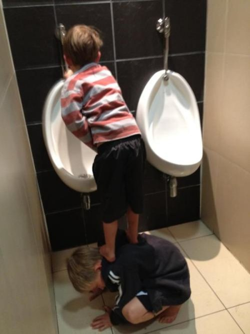 Kids Use Team Work to Get to Urinal This could possibly get very messy for everyone involved.