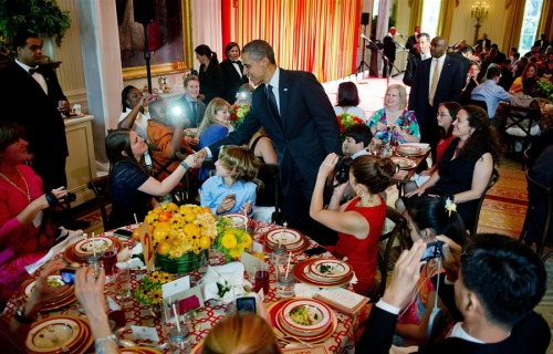 "Michelle Obama hosts kids' lunchtime 'state dinner' at White House (Photo: Jim Watson / AFP - Getty Images) AP reports — At the first ever White House ""kids state dinner,"" first lady Michelle Obama told America's top junior chefs Monday that the dishes they created are proving that fun eating can be ""healthy and tasty at the same time."" ""Your recipes truly stood out,"" she said to an East Room filled with kids who won a nationwide recipe competition. ""You came up with dishes that were packed with nutritious, delicious ingredients — dishes that are good for you but more importantly they taste good, too. See? It can happen."" The event was the latest effort in Mrs. Obama's ""Let's Move"" campaign to combat childhood obesity with more exercise and a better diet. View more photos in the Photoblog or read the complete story."