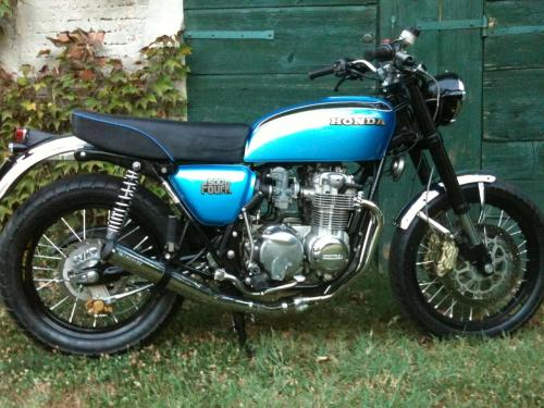 Saw this fantastic Honda CB500f on fellow tumblr blog  tomorrowmaybetomorrowmaybe and sent them a message asking for the source.  Google Translate helped me work out what has been done to the bike. New lightweight spoke wheels and hub Dual 300mm disc front brakes 4 Piston calipers Showa upside down forks  Motogadget Cronoclassic Seat upholstered New CB750 graphic on the tank Like us on FB