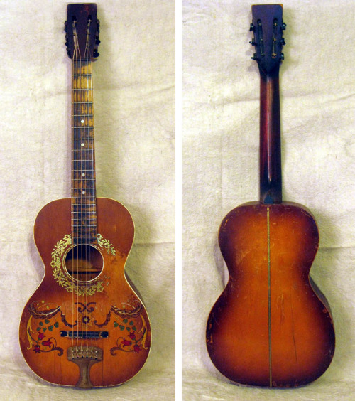 "Stella Floral Decalcomania Concert Guitar …Circa 1925 tailpiece model with all solid birch construction. Three repaired and cleated top cracks and one cleated back crack. This guitar has been played and played and it shows it! What's more, it sounds it! This is an exceptionally loud responsive guitar perfect for playing blues, rags, old-time country, you name it! You want an axe with loads of  ""mojo"", this is the one! Recent neck set, action is excellent. Stella Guitars & Other Oscar Schmidt Instruments"