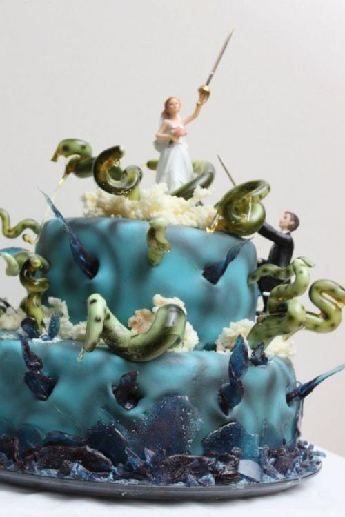 More wedding cakes should feature the happy couple fighting a hopeless battle against monstrous Elder Gods.