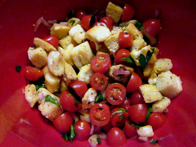 Panzanella Salad Day-old bread from Jimmy John's, Cherry Tomatoes, Red Onion, Garlic, Parsley, and Basil; tossed in Olive Oil and Red Wine Vinegar I highly suggest using Jimmy John's day-old bread for any recipe that calls for French bread. It's just the best - and it's 45 cents/loaf. I mean, come on.
