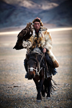 nightaftersidewalk:  A Mongolian Hunter with his pet Eagle