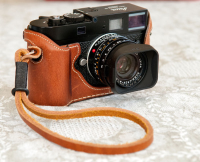 Larry S. M9-P My camera with your strap, which, I would like to add, is one of the best (and least expensive!) accessories I bought for my M9-P. It matches, beautifully, the multi-$$ Leicatime cognac case.
