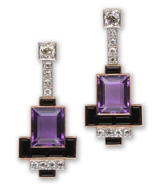 A pair of amethyst, onyx and diamond earrings each of geometric design, suspending a line of old European-cut diamonds with rectangular-cut amethyst and calibré-cut onyx terminals. Art Deco or Art Deco style.