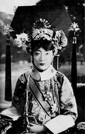 fuckyeahhistorycrushes:  Empress Xiaokemin (Wan Rong,) last Qing empress of China. She was married at 16 to Puyi, the final emperor in the Qing dynasty, and would later become the empress of the puppet state Manchukuo in the 1930s and 1940s. She was an educated woman who was fluent in English and loved to write letters to her friends, read mystery novels, dabble in photography, and play the piano. She lived a very bizarre and cloistered existence controlled by the Japanese in Manchukuo and turned to opium to dull the loneliness and pain of her husband's rejection. She died as a political prisoner at 39. This photo is of her on her wedding day, when she was really a beautiful girl.