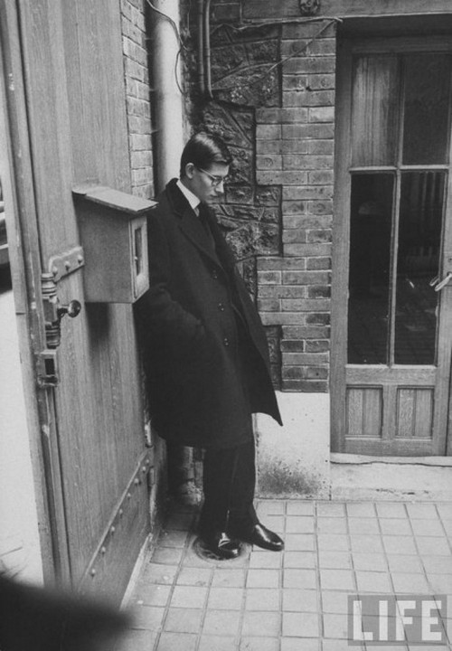 theniftyfifties:  Yves St Laurent photographed after the funeral of Christian Dior, October 1957.