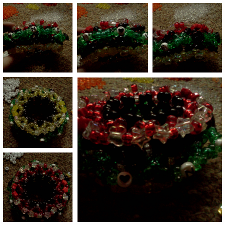 my first cage cuff~ lighting is terribleeee): rasta-themed, it says one love around the middle.  (this is going out for a trade :3)