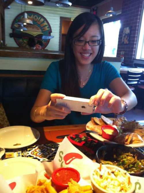finally caught her taking a pic of food! =D