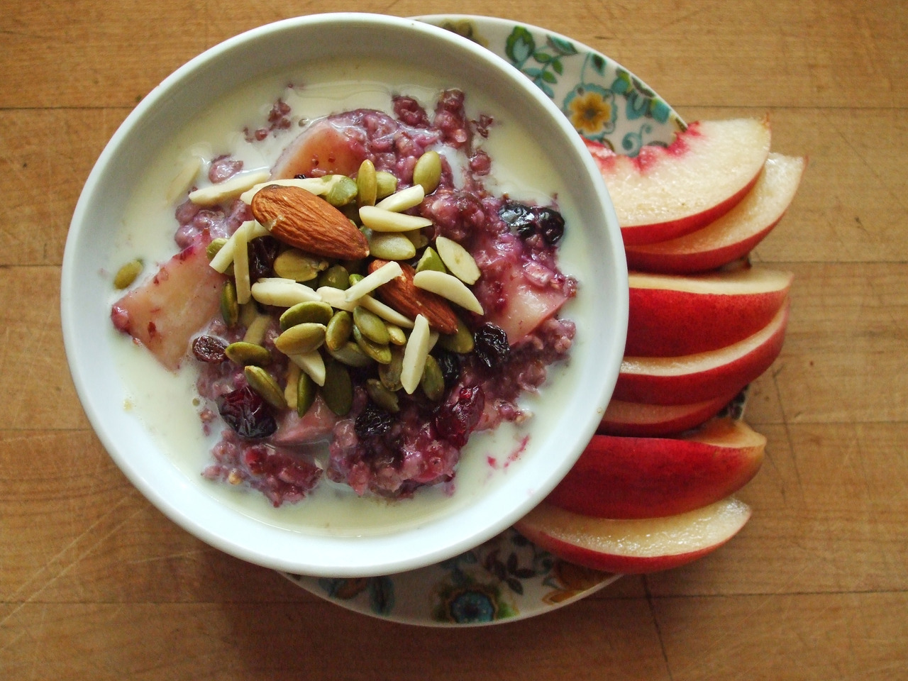 huckleberry-peach oatmeal with pumpkin seeds and almonds