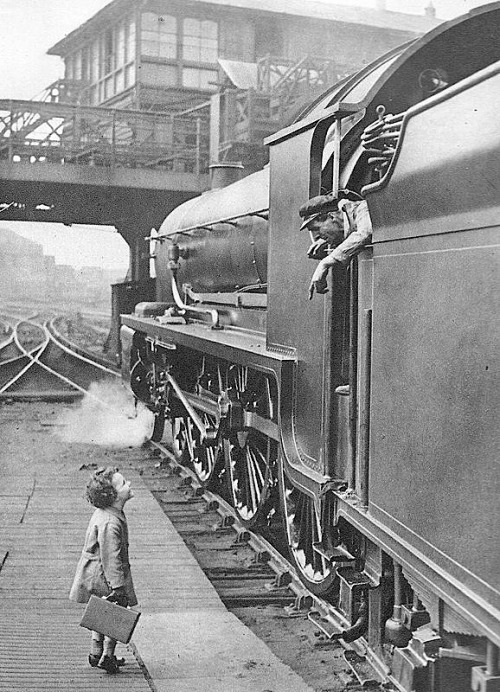 Little boy talking to the locomotive crew, Waterloo Station, 1924 From Southern Railway's advertising