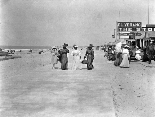 Four women stroll down the Newport Beach esplanade, circa 1905.