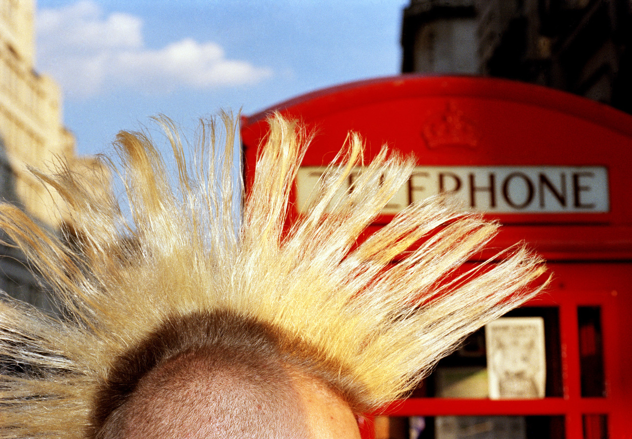 Martin Parr—Magnum 1997. Some punks kept their Mohican haircuts and lived by charging tourists money to photograph them (often by a red bus or telephone box). A new photo book by Taschen captures images of London from the Victorian era to the swinging '60s to the present day. See more photos here.