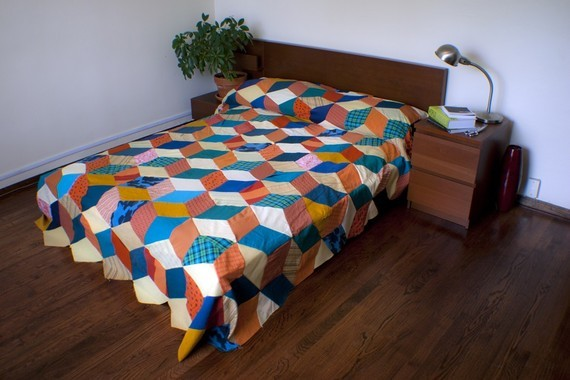 Tuesday is Decor Day! This week's pick is an awesome geometric patterned quilt made from recycled materials.