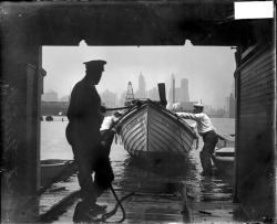 Two men pulling a boat on to a ramp inside a building on the north branch of the Chicago River in 1929. Photograph from Chicago Daily News. Want a copy of this photo?  > Visit our Rights and Reproductions Department and give them this number:DN-0088849. Connect with the Museum