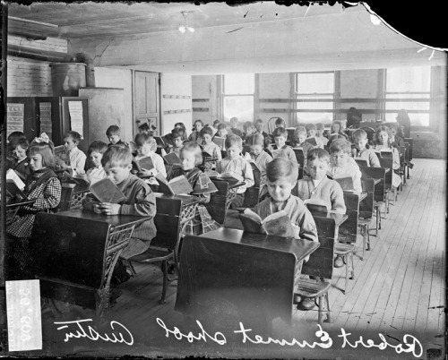 Children reading at the Robert Emmet School, 1911. The school was located at 5500 West Madison Street in the Austin community of Chicago, Illinois. Photograph from Chicago Daily News. Want a copy of this photo?  > Visit our Rights and Reproductions Department and give them this number: DN-0056609. Connect with the Museum