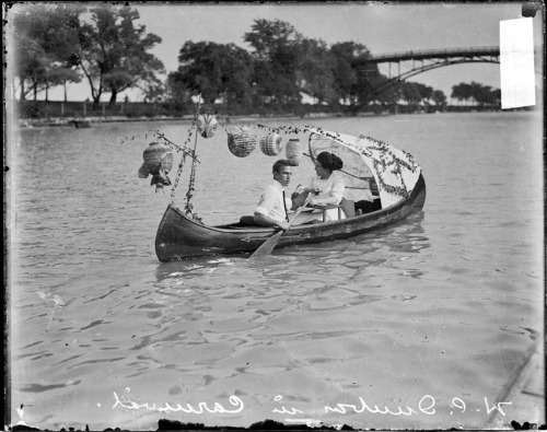 Portrait of W. C. Dunbar and an unidentified woman rowing a canoe in the Lincoln Park lagoon carnival in Chicago, Illinois, 1910. Photograph from Chicago Daily News. Want a copy of this photo?  > Visit our Rights and Reproductions Department and give them this number: DN-0056115. Connect with the Museum