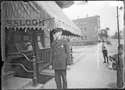 John Sullivan, fireman, standing outside the Thomas Farris saloon at 2200 West 13th Street in the Near West Side of Chicago, Illinois, 1910. Photograph from Chicago Daily News. Want a copy of this photo?  > Visit our Rights and Reproductions Department and give them this number: DN-0008604. Connect with the Museum