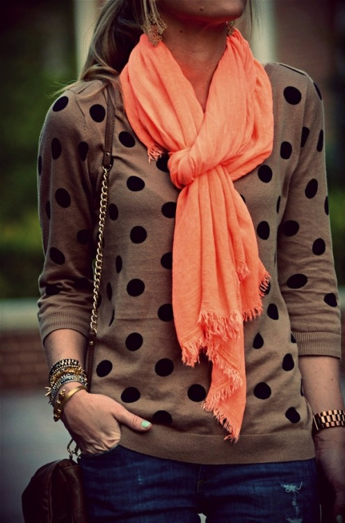 Polka dotted, long sleeved top with contrasting pink scarf. I like.