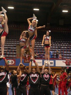 cheerleader-till-the-day-i-die:  cheer-flip-jump:  Bahahahaha. The girl on the rights face. Lmao  she's like please don't fall on me