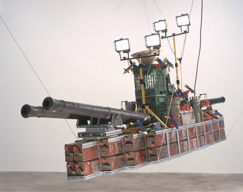 Chris Burden Bateau de Guerre 2001 Metal gasoline cans, plastic toys, metal lamps, plastic crates, straw hat, metal framework and two electric Erector motors. 180.3 x 442 x 104 cm
