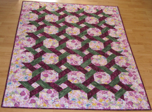Looks awesome with the lattice work on point and floral background fabric!