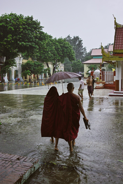 thesociologist:  BURMA. Mandalay. Walking in the rain. ⓒ Julie Mayfeng.