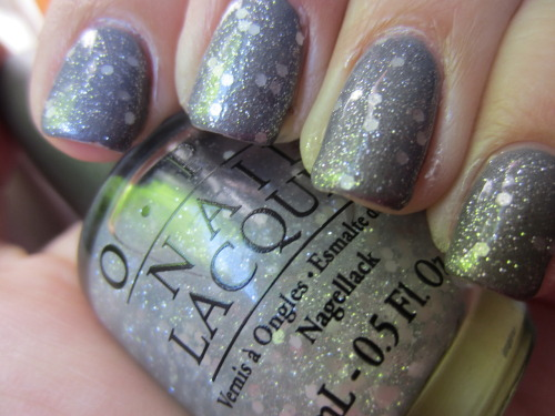 "pop beauty ""foggy"" with opi ""pirouette my whistle"" i freaking love pirouette my whistle! its a white chunky glitter with silver microglitter in a clear base! a little sheer tho.  this is 2 coats and i wanted to try it over grey first."